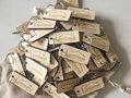Houten sleutelhangers gepersonaliseerd (100 stuks)